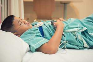 Asian boy in hospital wearing Sleep Apnea Diagnostic - stock photo