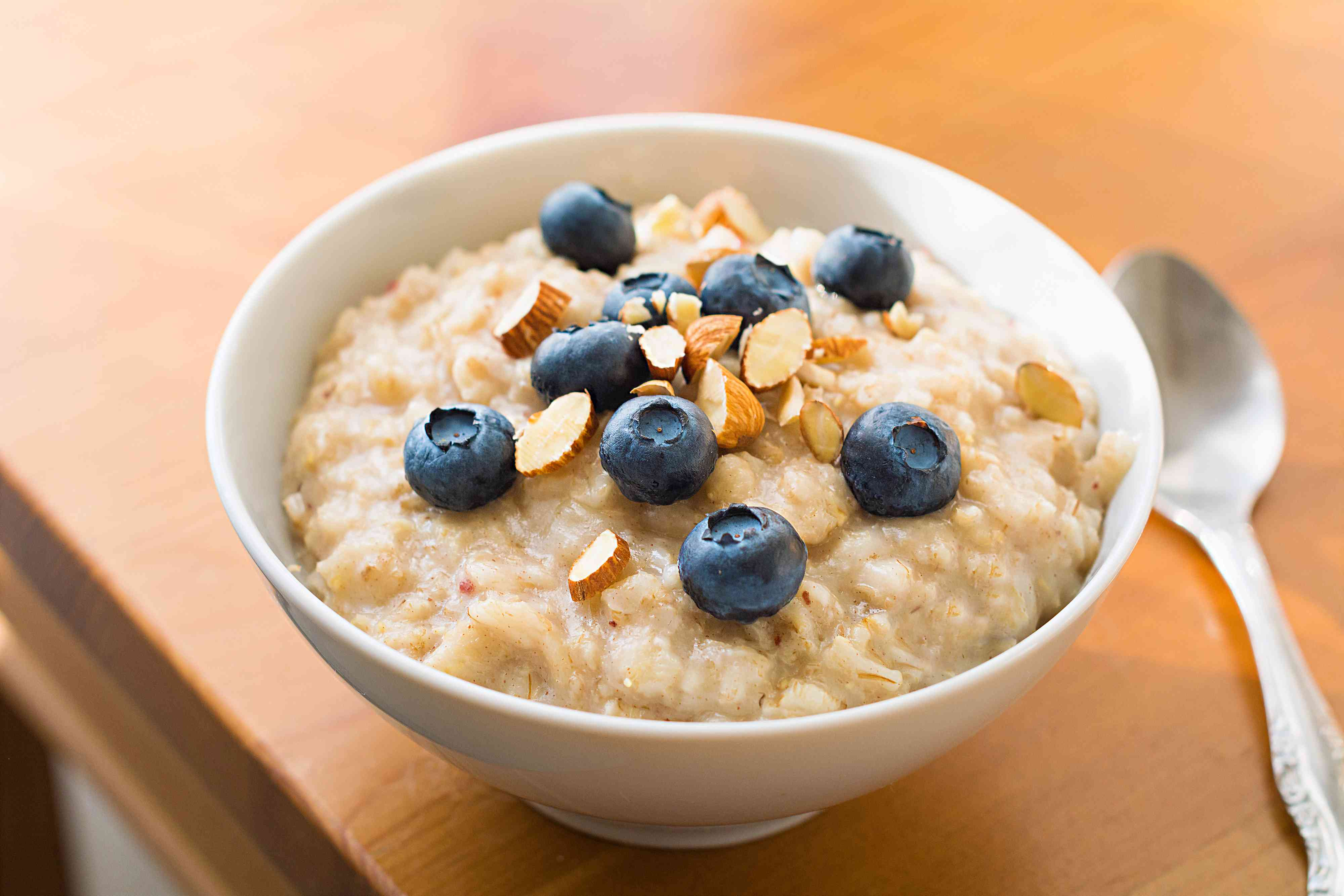 bowl of oatmeal with blueberries and almonds