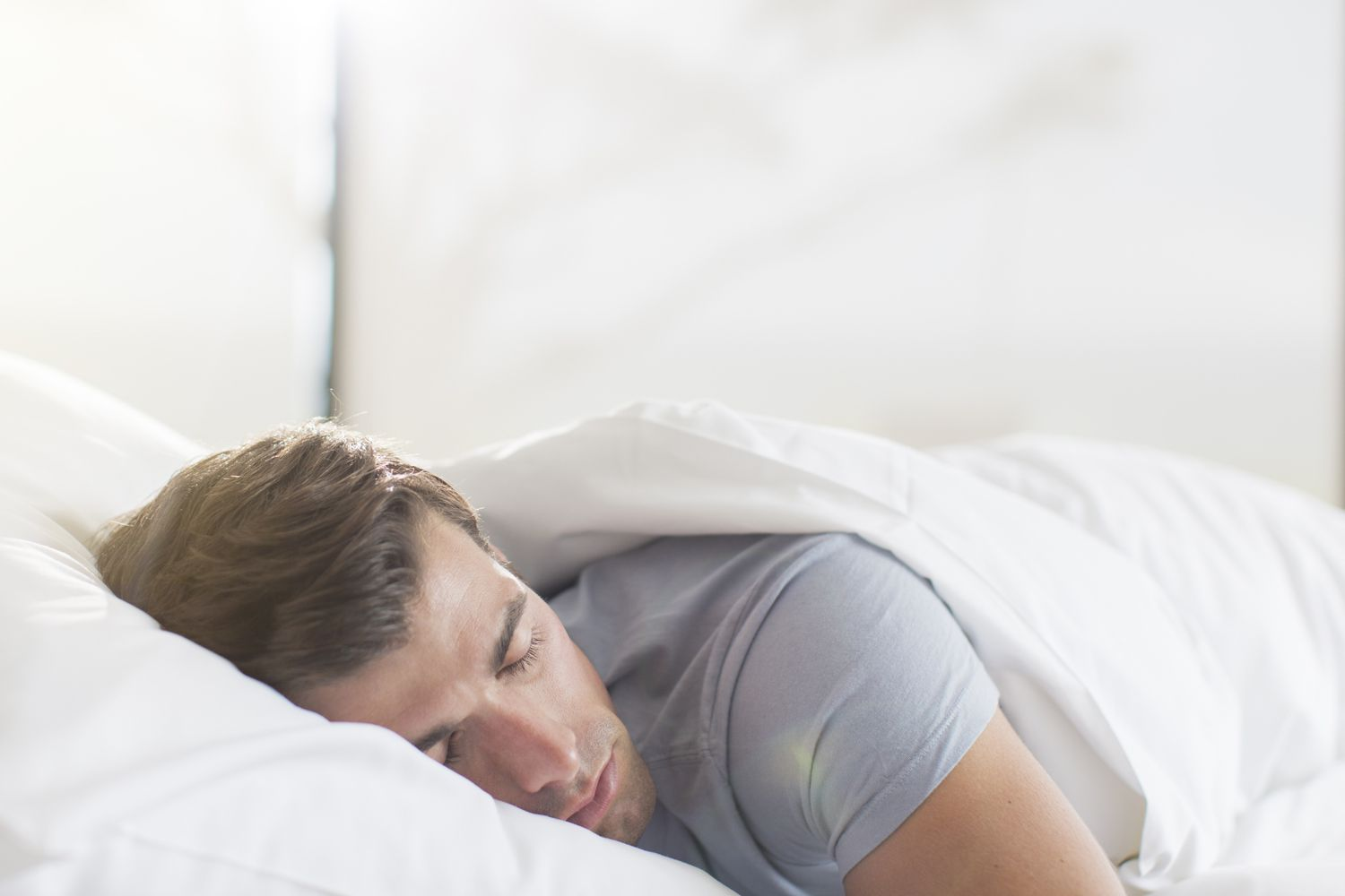 A man sleeping peacefully in his bed