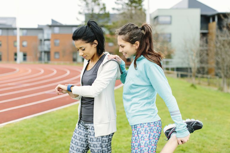 Two women checking out a fitness watch.