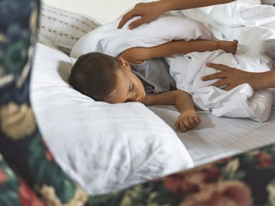 child with weighted blanket