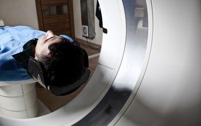 Man having a medical examination via CAT scanner