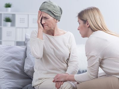 woman with advanced breast cancer learning about a complication