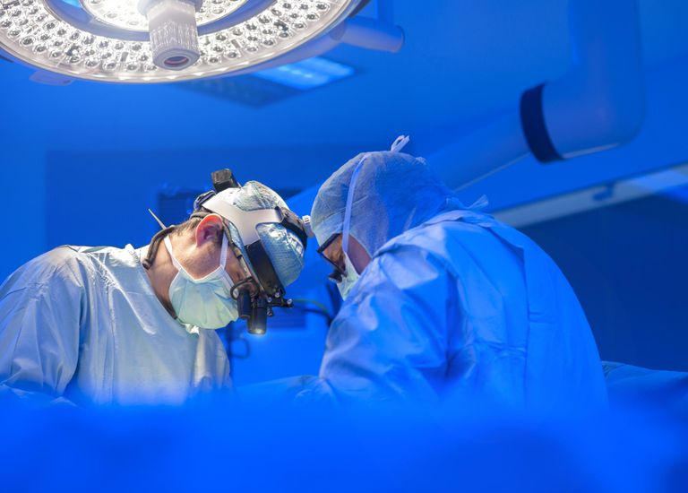 Surgeons performing open heart surgery