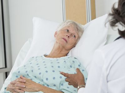 Doctor talking to patient in hospital - stock photo