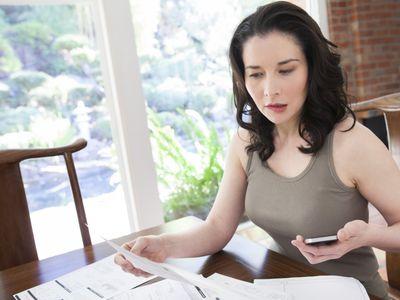 woman reading her bills