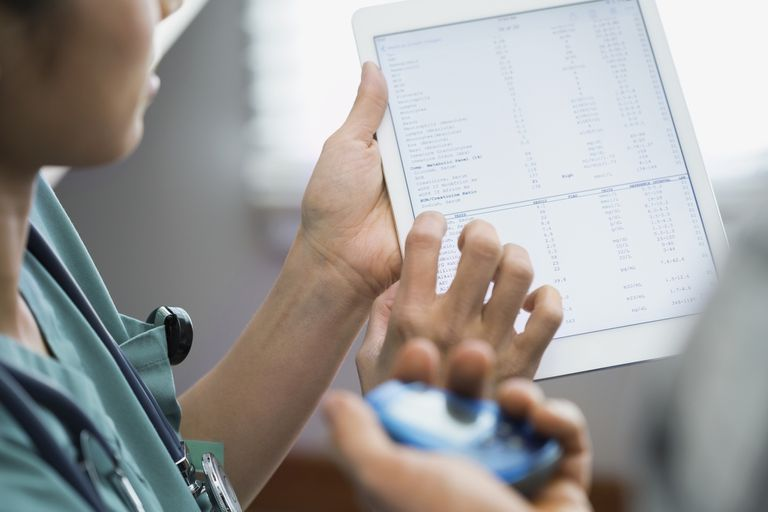 Nurse looking at medical records on a tablet