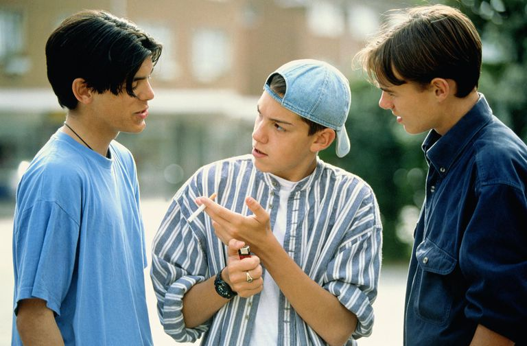 teen offering other boys a cigarette