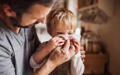 Child with cold and father