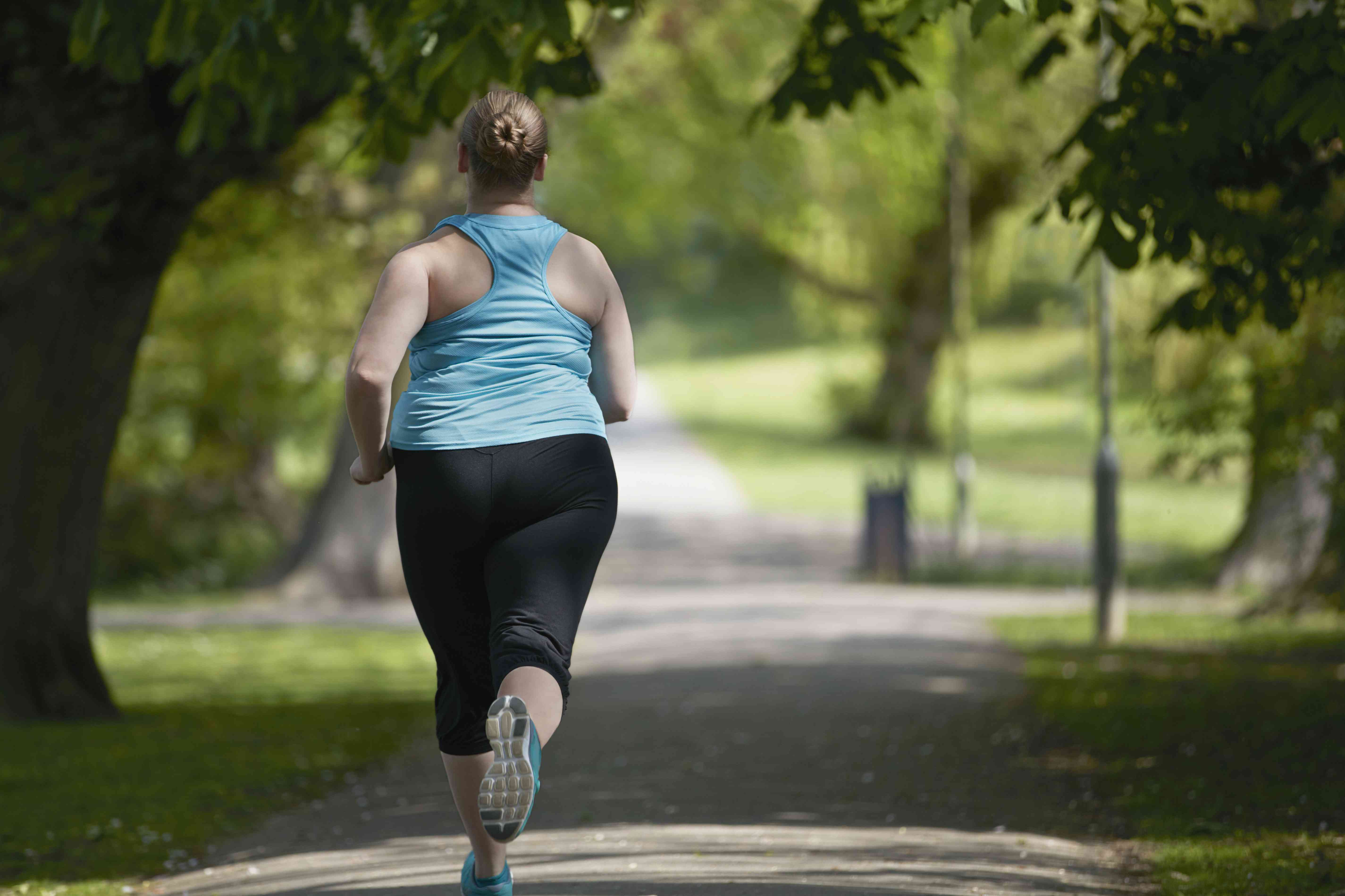 A woman running on a path in the park