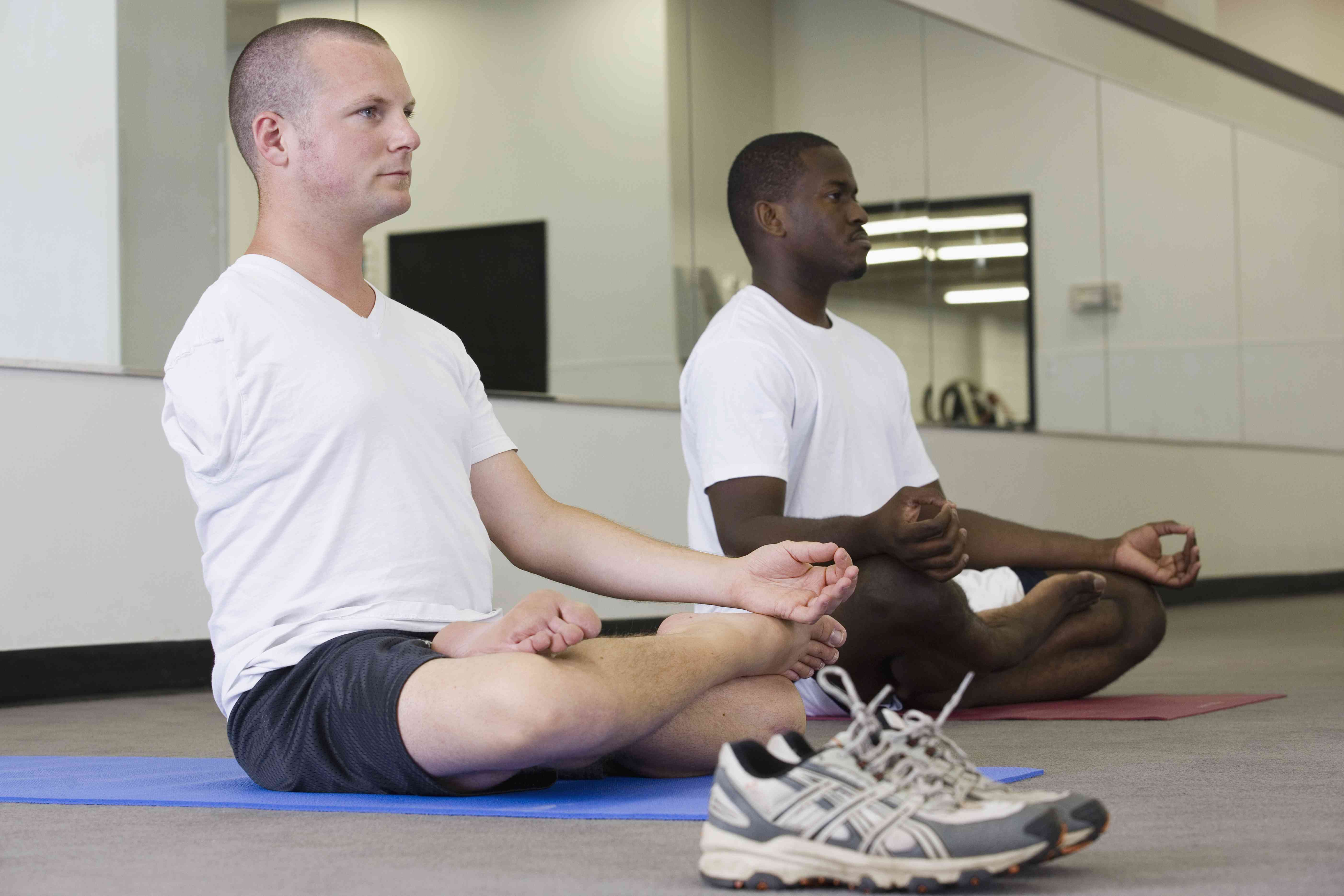 Two men benefiting from OT and adaptive yoga therapy.