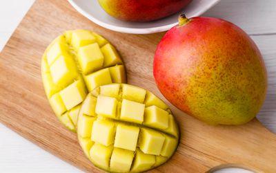 Mango on cutting board