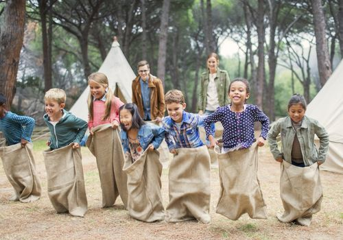 Kids starting a sack race