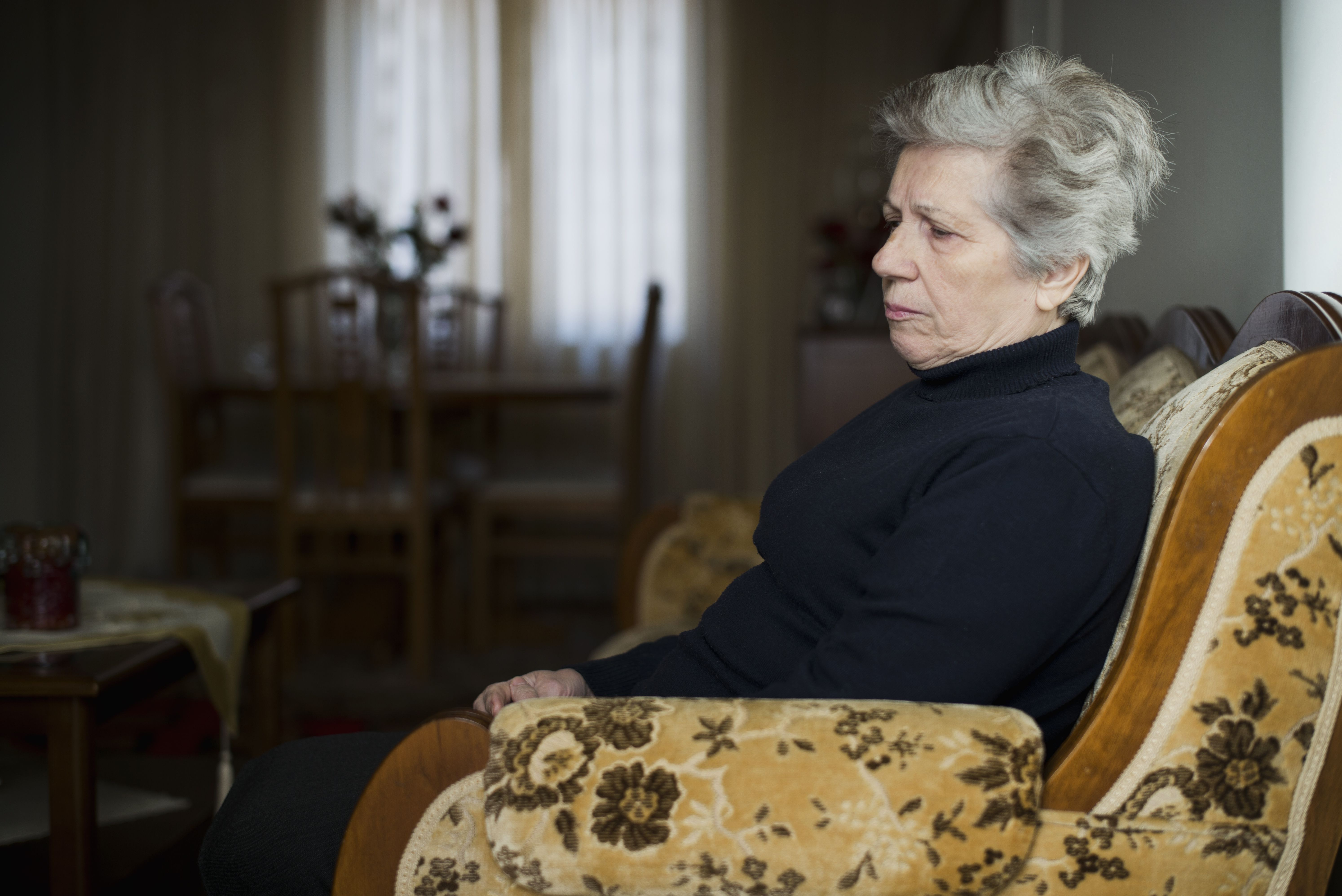 Retired woman relaxing in living room