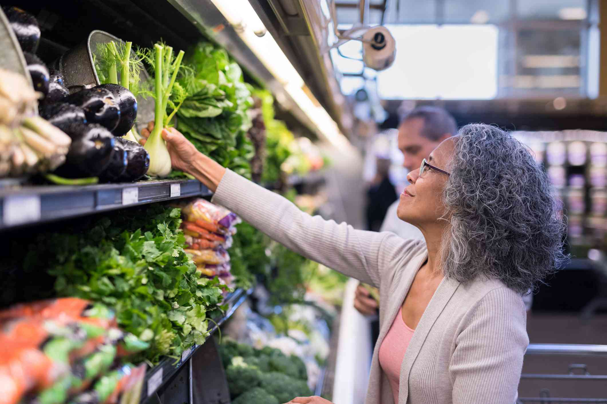 Woman shopping for heart-healthy food