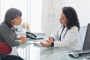Female doctor talking with a female patient