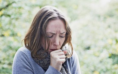 Woman coughing.