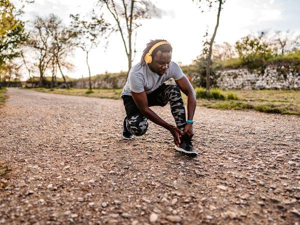 Man clutching ankle injury