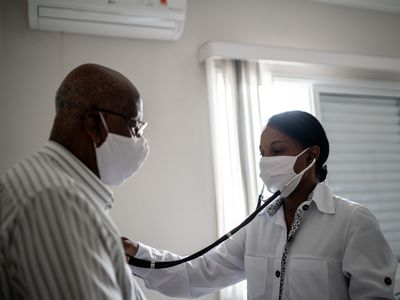 Doctor uses a stethoscope on a patient