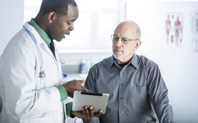 Doctor reviewing hip imaging with patient