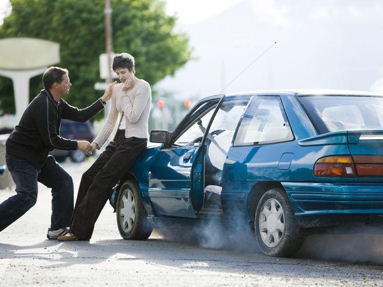 Good Samaritan helping woman at accident