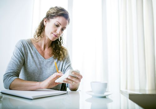 Woman calculating her taxes will pay no penalty if she has a health insurance exemption.