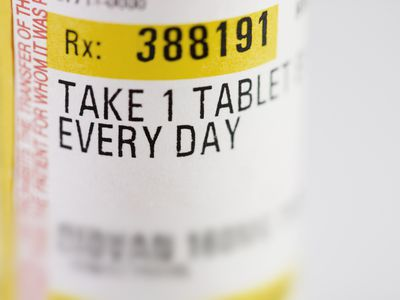 Instructions on a pill bottle - stock photo