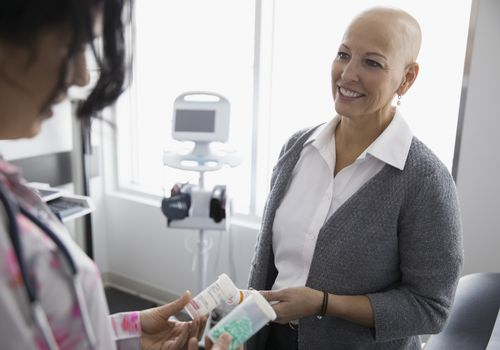 Female cancer patient listening to her doctor
