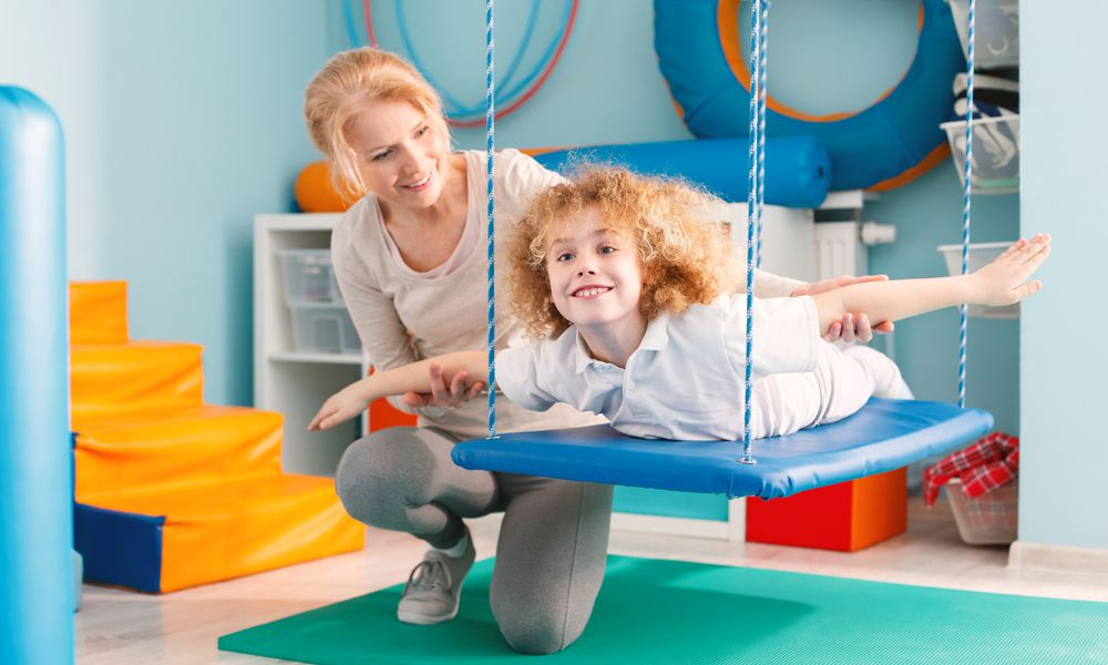 Child on therapeutic swing