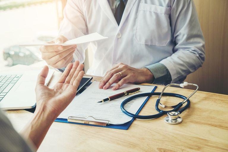 Doctor giving patient a prescription