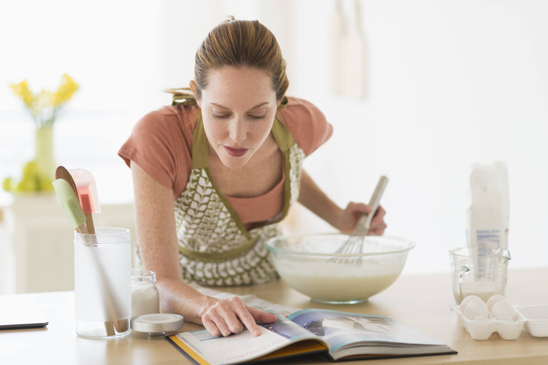A woman baking in the kitchen
