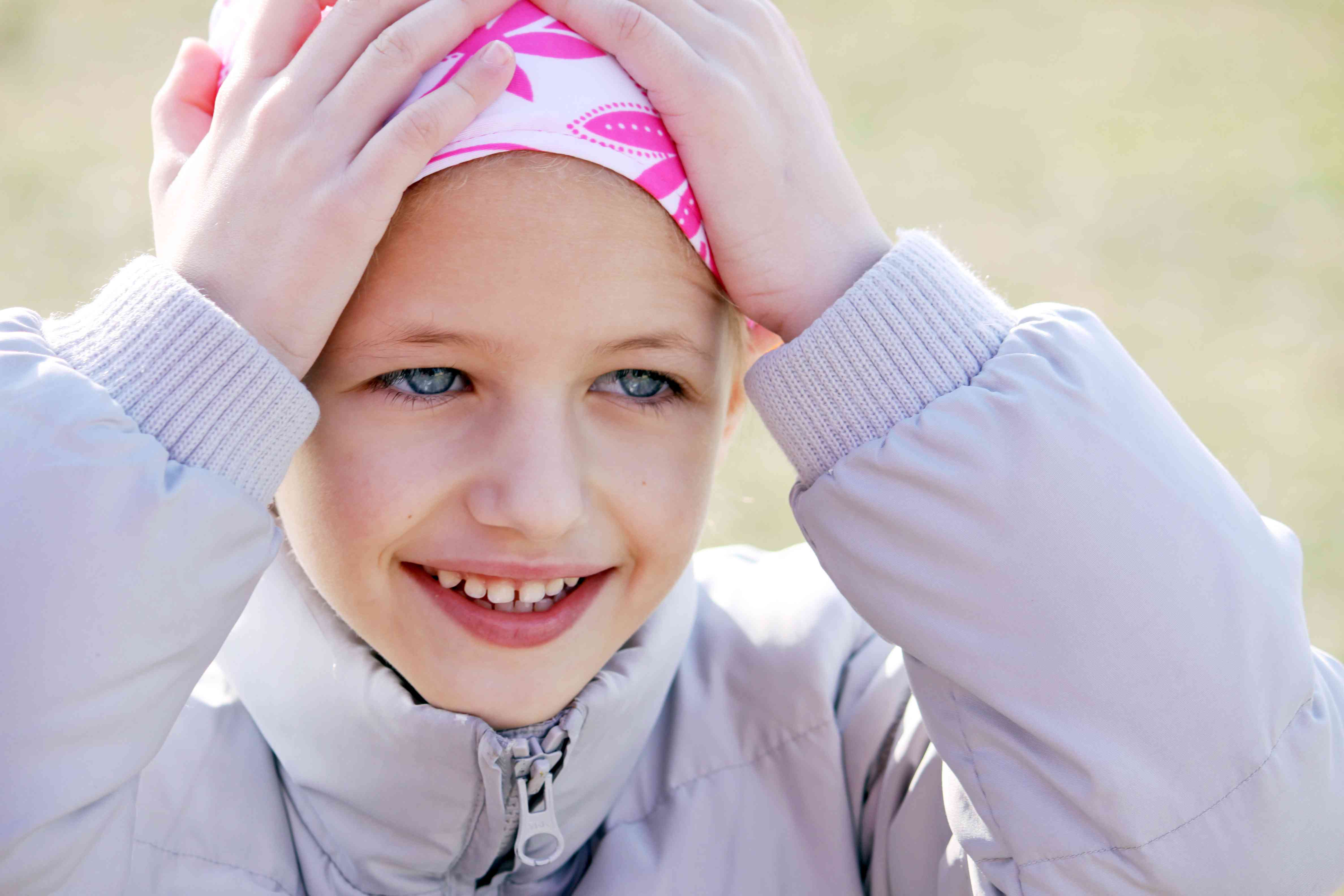 young girl wearing a head scarf