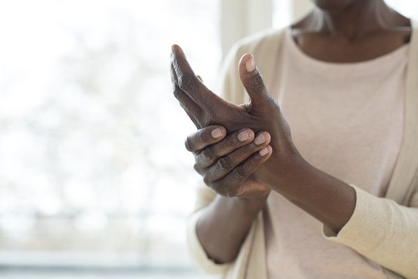 woman with pain in hand