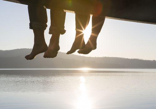 Feet dangling from dock