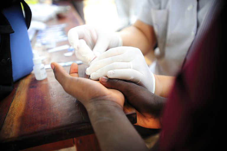 Woman having HIV test