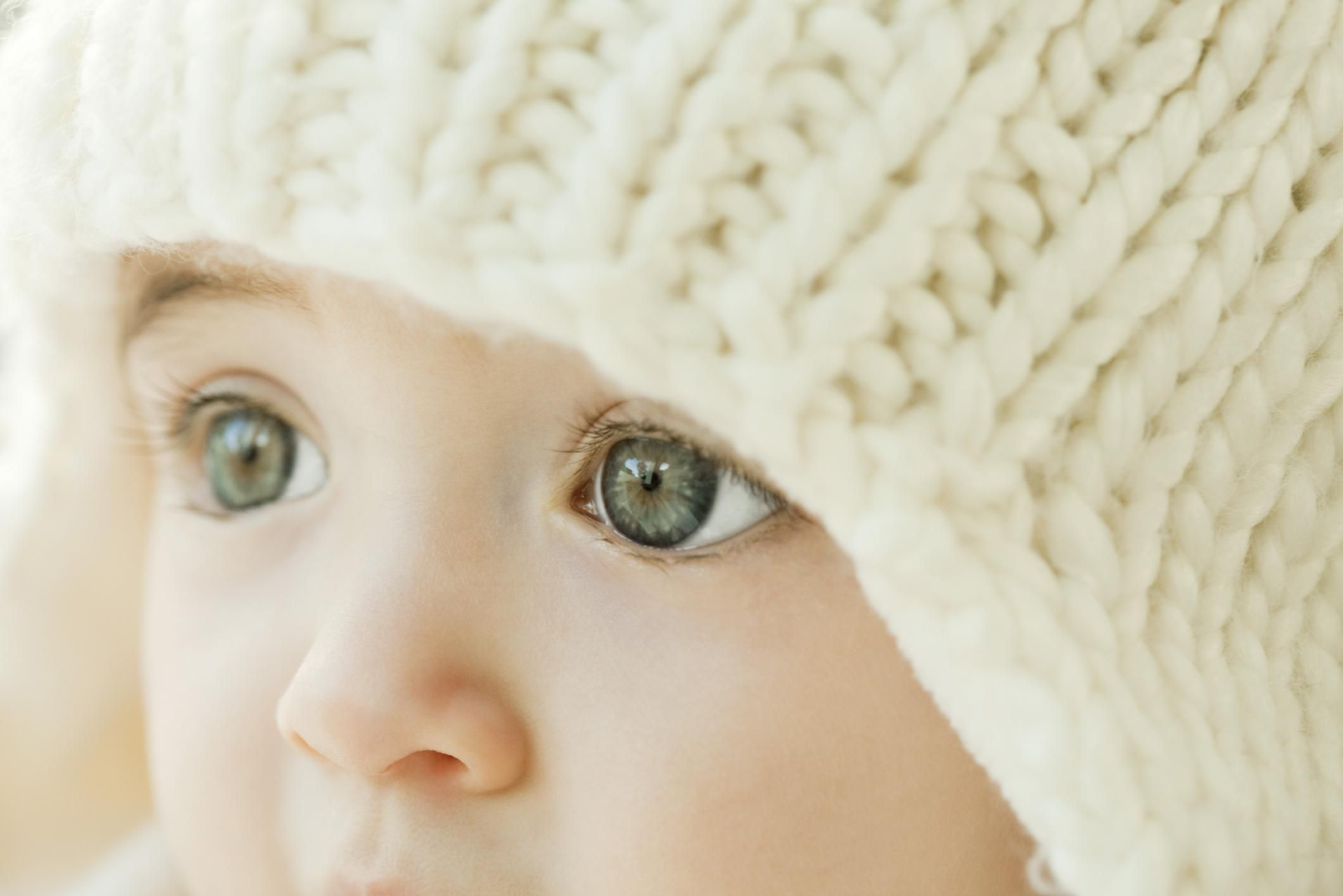 A baby with large, blue eyes