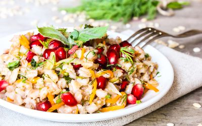 Warm barley salad with carrots, pomegranate seeds, and fresh mint