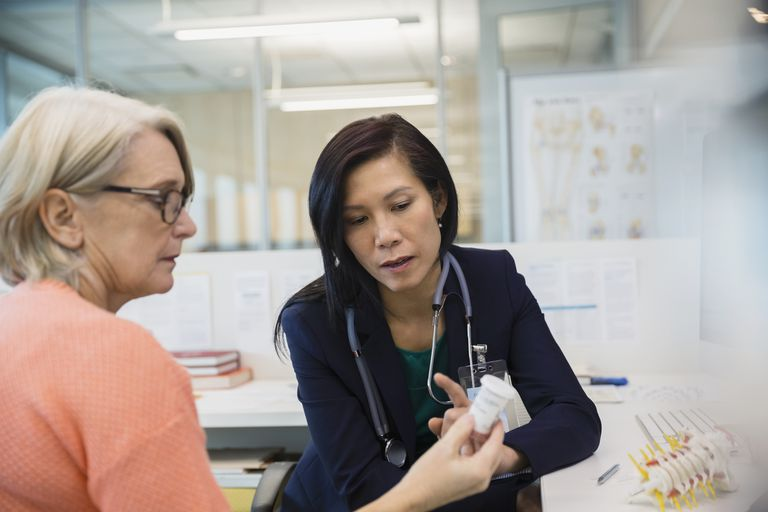 doctor talking to female patient about medication