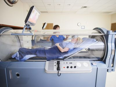 Woman laying in hyperbaric chamber