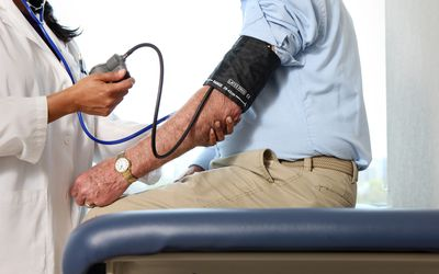 A man having his blood pressure checked