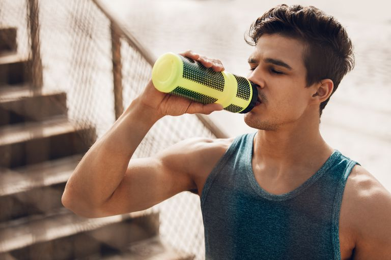 runner drinking a joint supplement