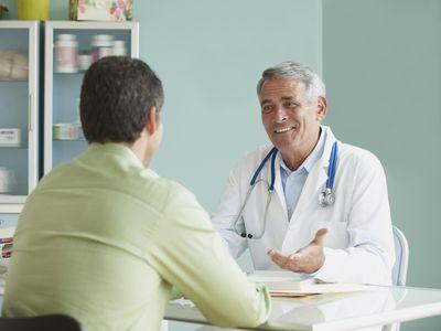 Doctor Speaking To Patient In Office