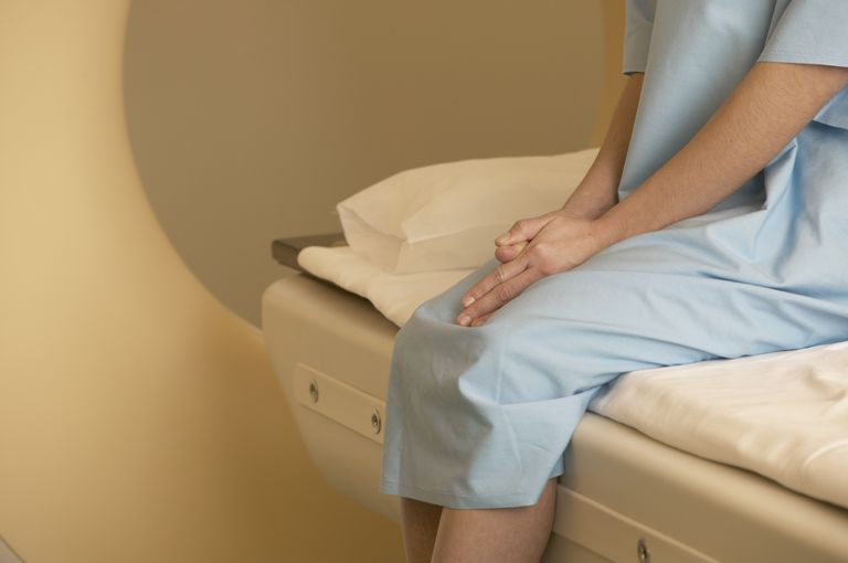 woman waiting on MRI table