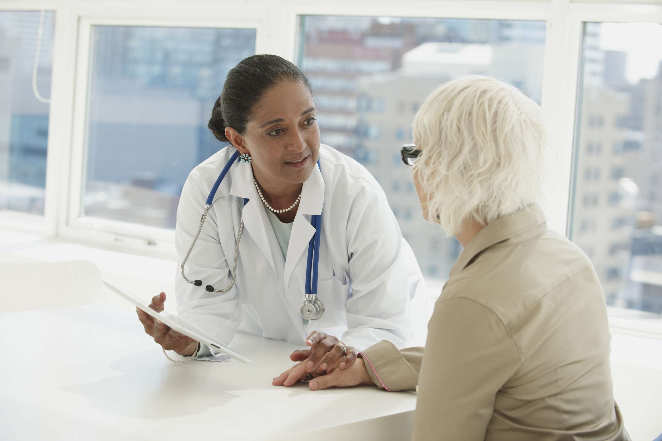 Doctor performs neurological and cognitive exam with senior patient