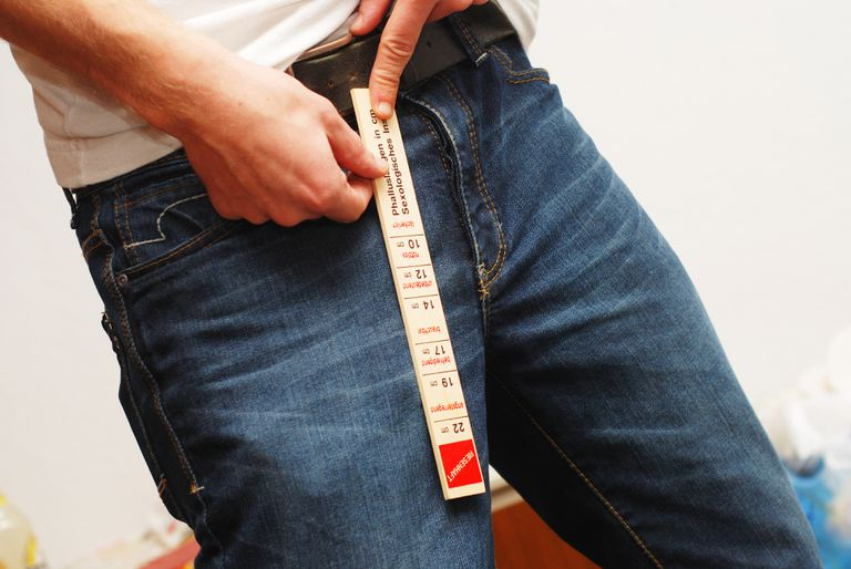 man measuring penis through jeans