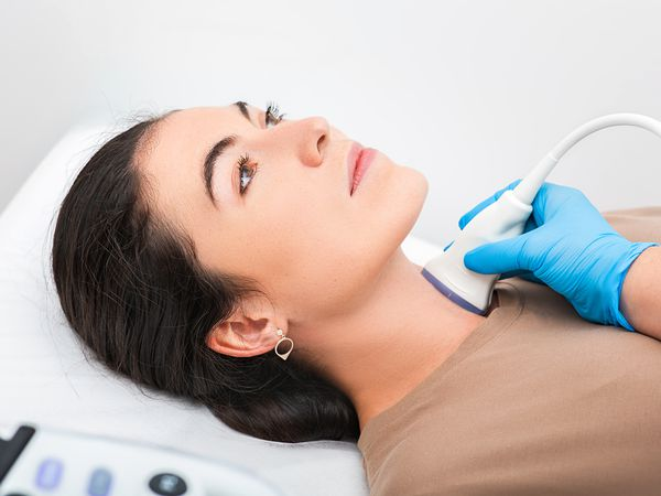 woman getting ultrasound on thyroid