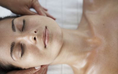 A woman getting massage therapy for her TMJ