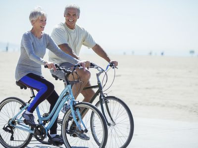 an older couple riding bicycles