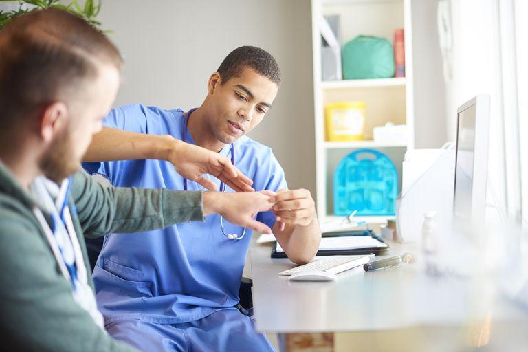 Doctor examining patient's hand
