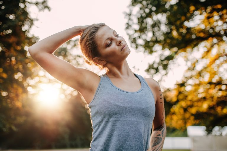 Fitness woman warming up in park
